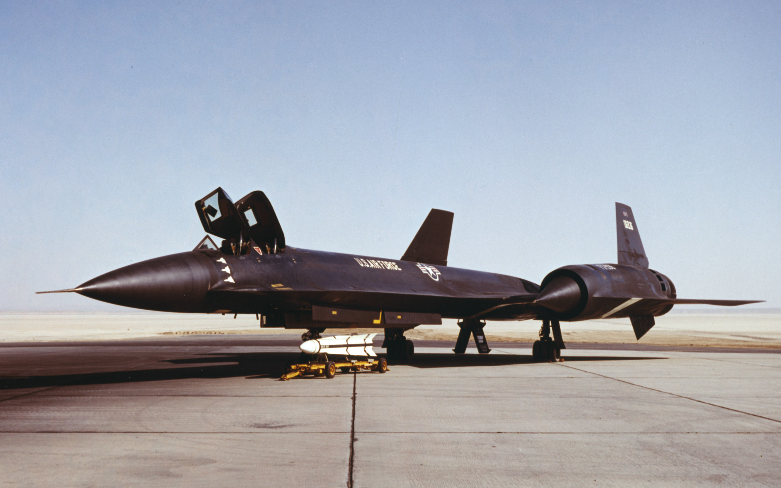A Hughes AIM-47 missile sits next to the third Lockheed YF-12A Blackbird at Edwards AFB. The white silhouettes on the forward fuselage denote the speed and altitude records set in May 1965. (AFTC/HO photo)