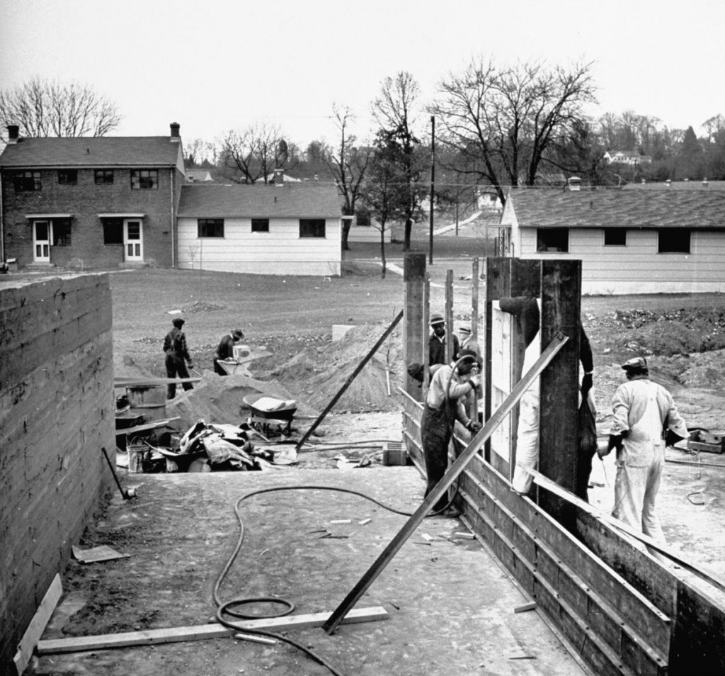 Workers building Cameron Valley in Alexandria circa early 1940s. Cameron was one of three wartime housing projects completed in Alexandria during World War II.